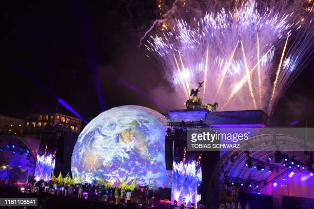 Fireworks are seen during the public show for the 30th anniversary of the fall of the Berlin Wall, on November 9, 2019 at the Brandenburg Gate in...