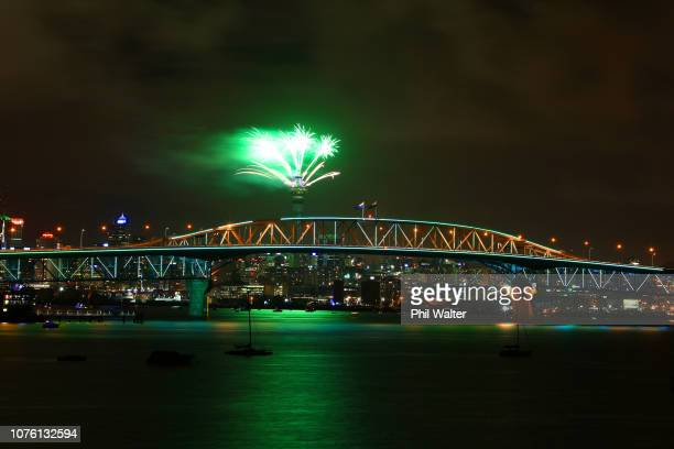 Fireworks are seen exploding from the Sky Tower with the Auckland Harbour Bridge in the foreground during the Auckland New Year's Eve celebrations on...