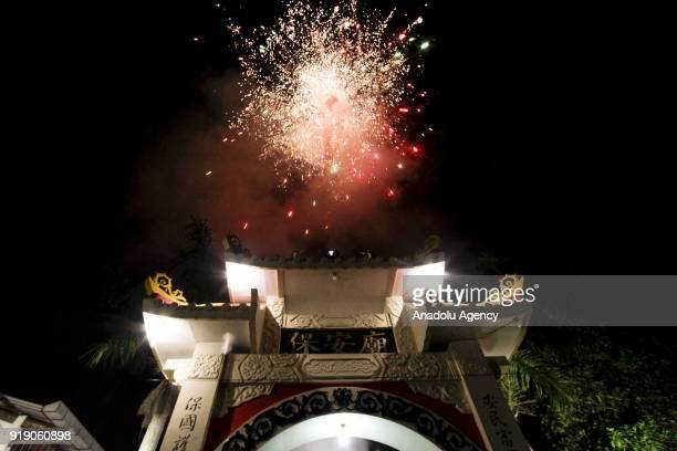 Fireworks are seen in front of the Poo An Bio temple as a part of the Lunar New Year celebration in Lasem village of Rembang regency in Central Java...