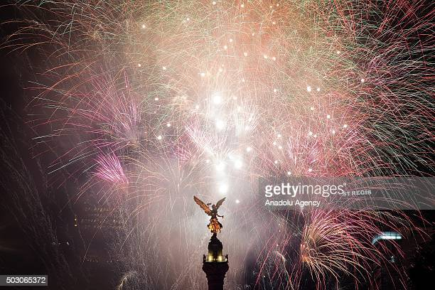 Fireworks are seen in the Angel de la Independencia in the New Year's eve celebrations in Mexico City Mexico on December 31 2015