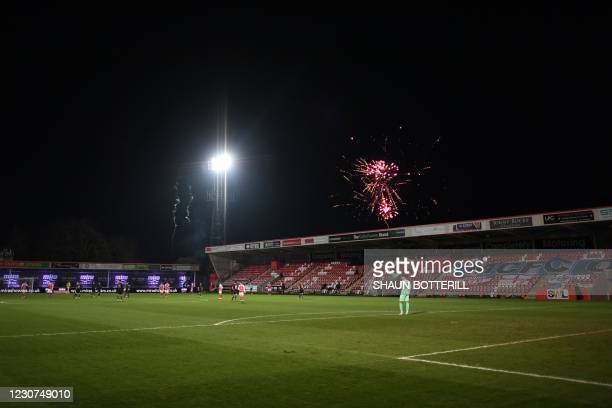 Fireworks are seen in the sky behind the grandstand causing a delay in play during the English FA Cup fourth round football match between Cheltenham...