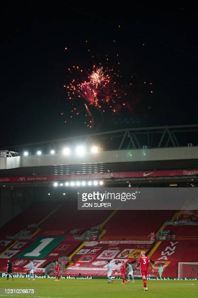 Fireworks are seen in the sky behind the Kop during the English Premier League football match between Liverpool and Manchester City at Anfield in...