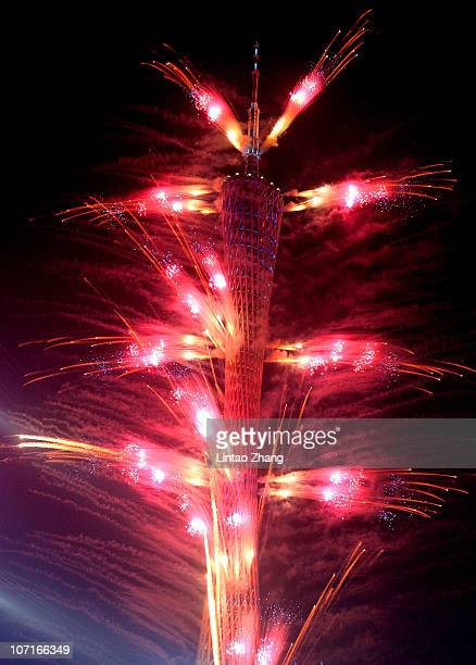 Fireworks are seen off the Canton Tower during the Closing Ceremony at Haixinsha Square on day fifteen of the 16th Asian Games Guangzhou 2010 on...