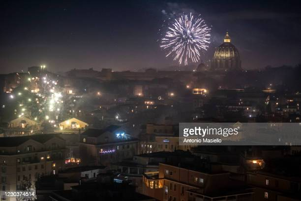 Fireworks are seen over St. Peter's Basilica on New Year's Eve during the Coronavirus pandemic on January 01 in Rome, Italy. The Italian government...