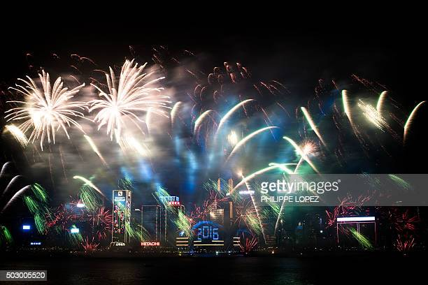 Fireworks are seen over the city's skyline in Hong Kong on January 1 2016 as part of the 2016 new year celebrations AFP PHOTO / Philippe Lopez / AFP...