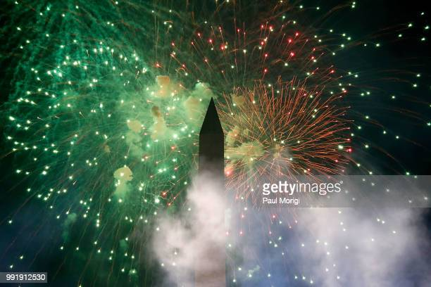 Fireworks are seen over the Washington Monument during the 2018 A Capitol Fourth at the US Capitol West Lawn on July 4 2018 in Washington DC