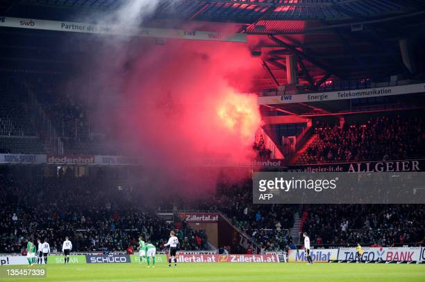 Fireworks are set by supporters during the German first division Bundesliga football match SV Werder Bremen vs VfL Wolfsburg in the northern German...