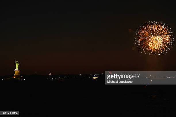 Fireworks are set off at Liberty State Park during the ''Freedom Fireworks Festival'' in Jersey City New Jersey on July 4 2014 as seen from New York...
