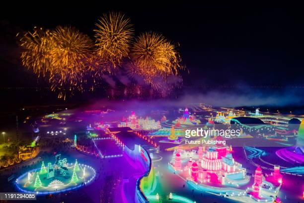 HARBIN CHINA JANUARY 1 2020 Fireworks are set off to celebrate the new year in Harbin Ice and snow world Harbin Heilongjiang Province China at 000 on...
