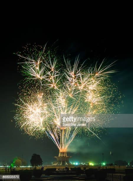fireworks at minar-e-pakistan - minar e pakistan stock pictures, royalty-free photos & images
