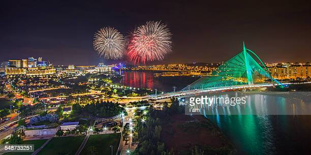 fireworks at putrajaya lakeside - putrajaya stock photos and pictures
