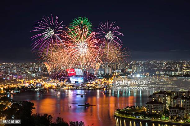 fireworks at singapore sports hub - national holiday stock pictures, royalty-free photos & images
