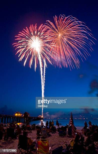 fireworks at the beach red bursts with light in sky - naples florida stock pictures, royalty-free photos & images