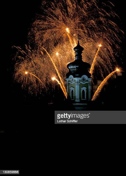 Fireworks behind church tower with onion-dome; Munich (Neuhausen quarter), Bavaria, Germany