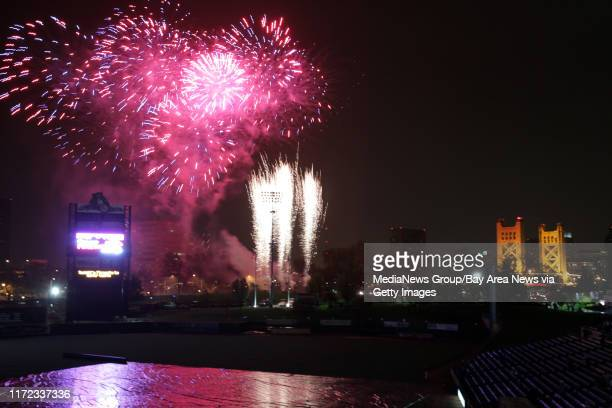 Fireworks blast over the Raley Field in Sacramento, Calif., after an exhibition game was rained out in the seventh inning between the Oakland...
