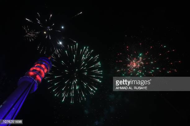 Fireworks burst above the Baghdad Tower in the Iraqi capital Baghdad on January 1 2019 as Iraqis welcome the New Year when the tower was also opened...