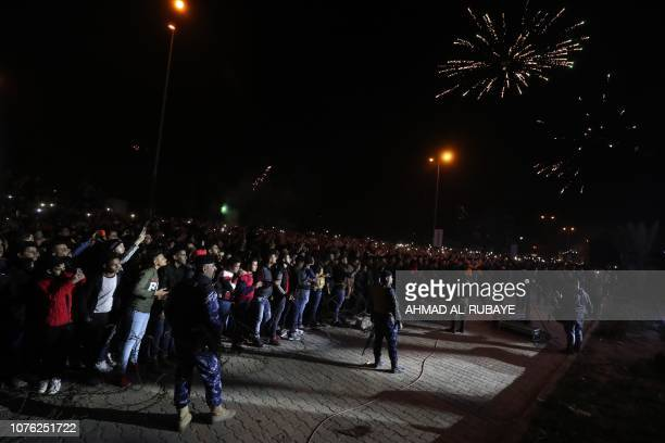 Fireworks burst above the Baghdad Tower in the Iraqi capital Baghdad on January 1 2019 with Iraqis welcoming the New Year as the tower is also opened...