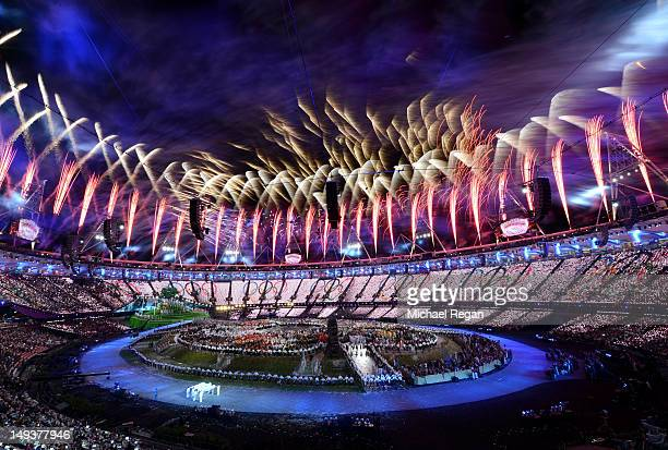 Fireworks burst above the stadium during the Opening Ceremony of the London 2012 Olympic Games at the Olympic Stadium on July 27, 2012 in London,...