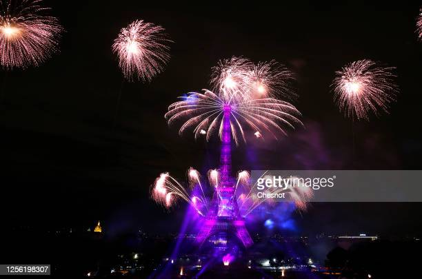 Fireworks burst around the Eiffel Tower as part of Bastille Day celebrations on July 14 2020 in Paris France The fireworks from the Eiffel Tower took...