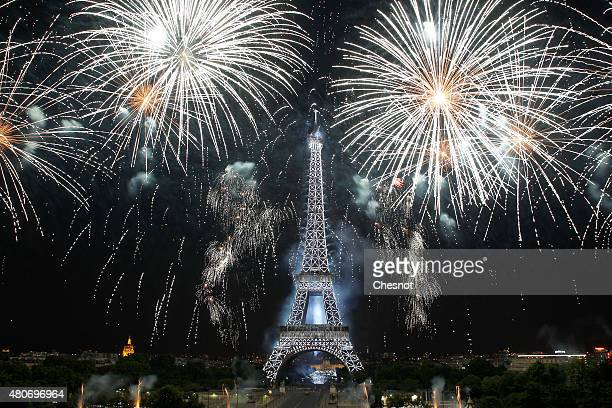 Fireworks burst around the Eiffel Tower as part of Bastille Day celebrations on July 14 2015 in Paris France Bastille Day commemorates the storming...