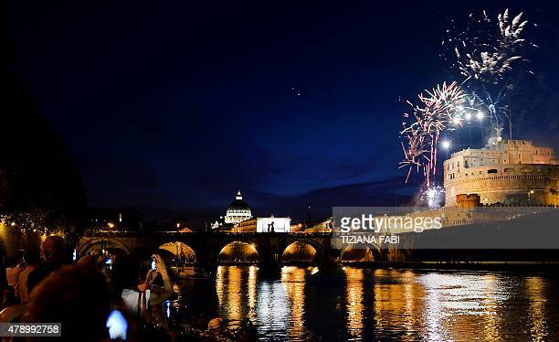 Fireworks burst in the sky over the Castel Sant'Angelo during the traditional 'Girandola' the feast of Romes patron St Peter and Paul on June 29 2015...