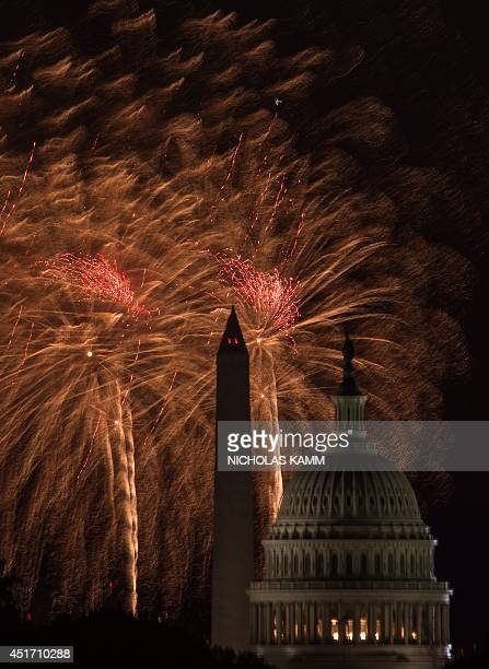 Fireworks burst out over the US Capitol and the Washington Monument during Independence Day celebrations in Washington on July 4 2014 AFP...