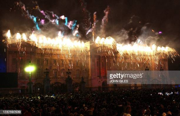 Fireworks burst over Buckingham Palace in London Monday 03 June 2002, after Britain's Queen Elizabeth II lit a beacon to commemorate her Golden...