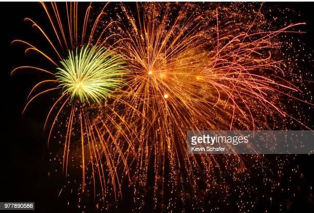 fireworks burst over ocean, manzanita, oregon, july 4th - manzanita stock pictures, royalty-free photos & images