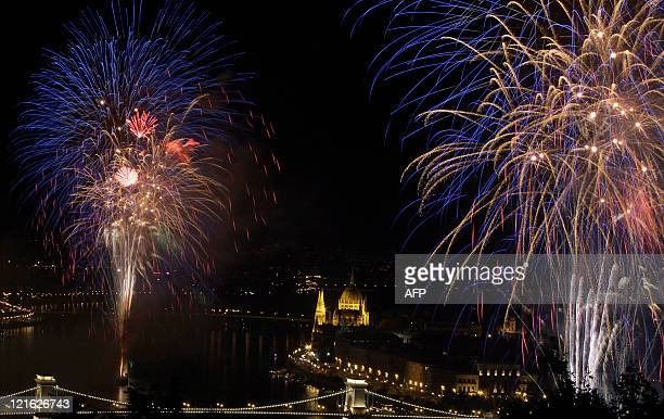 Fireworks burst over the Chain Bridge Hungary's oldest bridge on the Danube River of Budapest downtown late on August 20 2011 at the end of the...