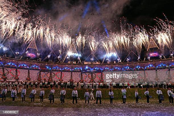 Fireworks burst over the Olympic Stadium during the opening ceremony of the London 2012 Olympic Games on July 27 2012 in London AFP PHOTO /POOL/...