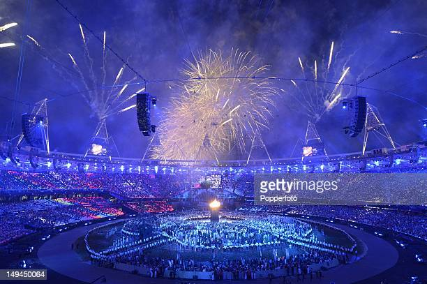 Fireworks burst over the Olympic Stadium during the Opening Ceremony of the London 2012 Olympic Games at the Olympic Stadium on July 27 2012 in...