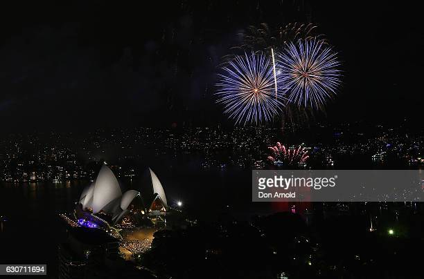 Fireworks can be seen during the Family Fireworks display on New Year's Eve on Sydney Harbour on Decemeber 31 2016 in Sydney Australia