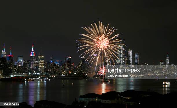 Fireworks celebrating Pride Day in New York City illuminate the sky over the Hudson River and One World Trade Center on June 24, 2018 as seen from...