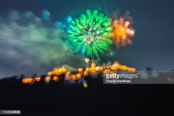 a fireworks display against the night sky - fourth of july background stock pictures, royalty-free photos & images