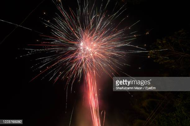 fireworks display during eid al-fitr - shaifulzamri stock pictures, royalty-free photos & images