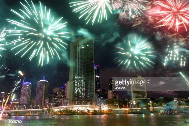 Fireworks display for Christmas over Southbank Parklands and Brisbane City River in Queensland Australia