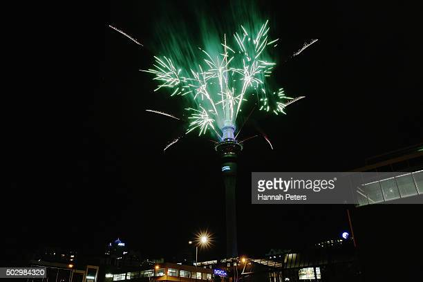 A fireworks display is launched from the Auckland Sky Tower during New Year's Eve celebrations on January 1 2016 in Auckland New Zealand
