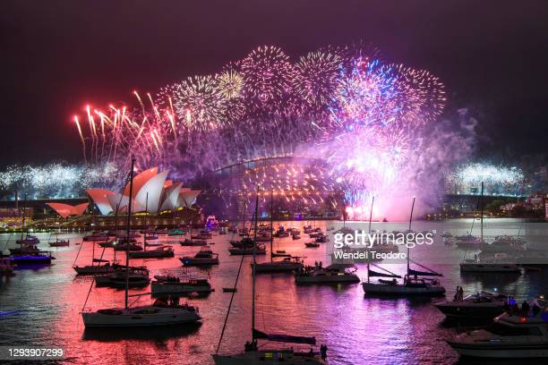 Fireworks display is seen over the Sydney Harbour Bridge during New Year's Eve celebrations on January 01, 2021 in Sydney, Australia. Celebrations...