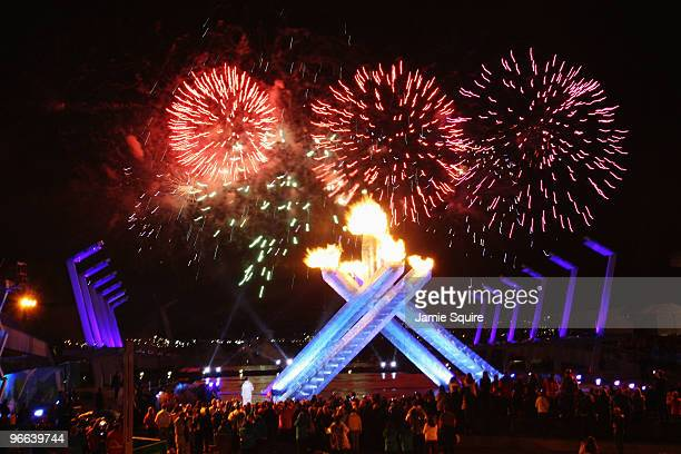 Fireworks display over the Olympic Cauldron during the Opening Ceremony of the 2010 Vancouver Winter Olympics at BC Place on February 12, 2010 in...