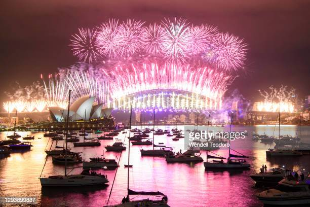 Fireworks display over the Sydney Harbour Bridge during New Year's Eve celebrations on January 01, 2021 in Sydney, Australia. Celebrations look...