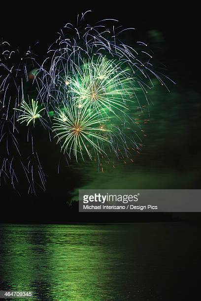 Fireworks Displays Reflecting Off Water