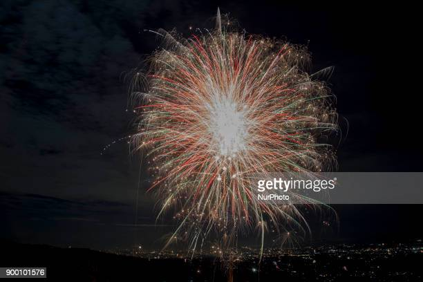 Fireworks entering the new year of 2018 at CipelangBogor Indonesia on 1st January 2018 People from Jakarta and surrounding area of Bogor enjoying new...