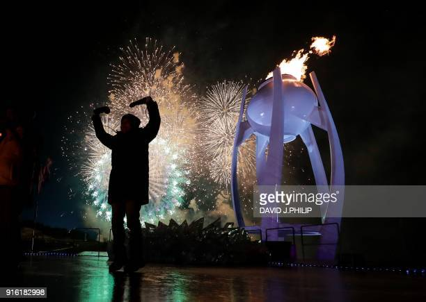 Fireworks erupt as the cauldron is lit with the Olympic flame during the opening ceremony of the Pyeongchang 2018 Winter Olympic Games at the...
