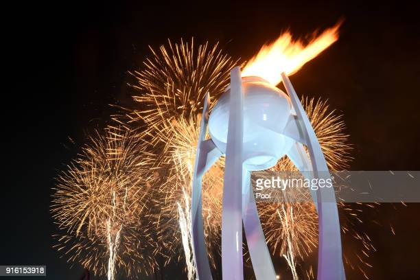 Fireworks erupt as the Olympic Cauldron is lit during the Opening Ceremony of the PyeongChang 2018 Winter Olympic Games at PyeongChang Olympic...
