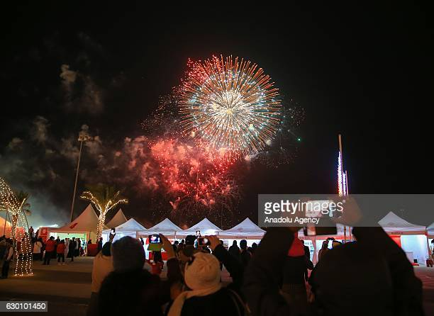 Fireworks erupt during the Bahrain National Day celebrations in Manama's Sukhair district Bahrain on December 16 2016
