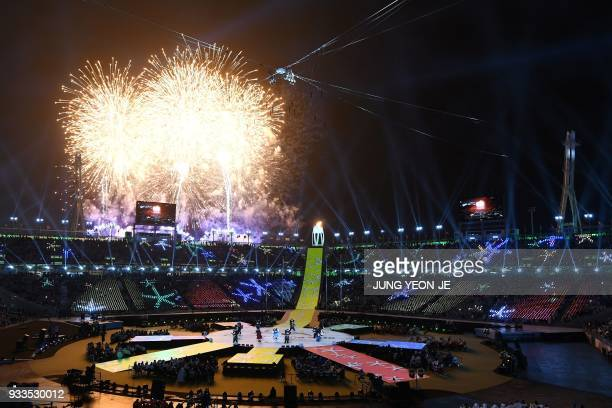 TOPSHOT Fireworks erupt during the closing ceremony of the Pyeongchang 2018 Winter Paralympic Games at the Pyeongchang Stadium in Pyeongchang on...