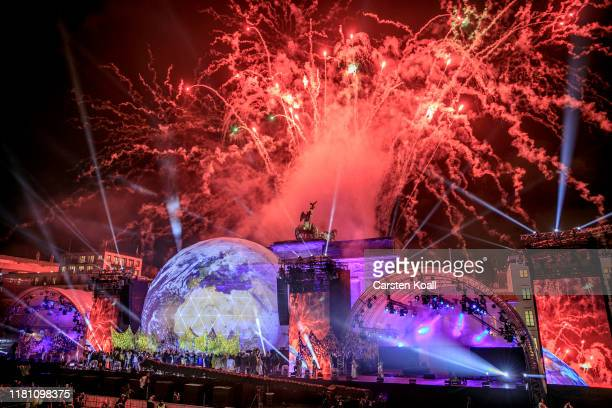 Fireworks erupt over the Brandenburg Gate during celebrations on the 30th anniversary of the fall of the Berlin Wall on November 9 2019 in Berlin...