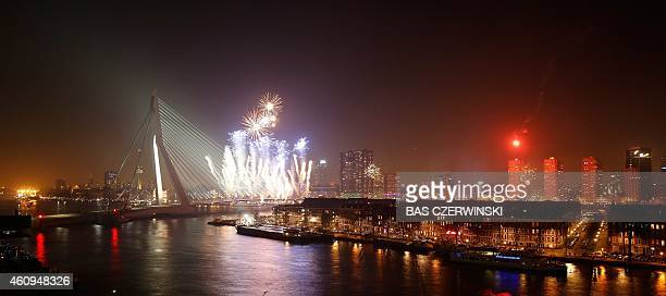 Fireworks erupt over the Erasmus Bridge in Rotterdam to mark the arrival of the new year early on January 1 2015 AFP PHOTO/ ANP / BAS CZERWINSKI...