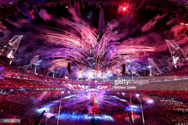 Fireworks expload as the Olympic Cauldron is slowly lowered during the Closing Ceremony on Day 16 of the London 2012 Olympic Games at Olympic Stadium...