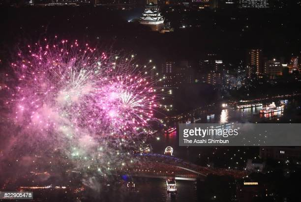 Fireworks explode above Okawa River during the Tenjin Festival on July 24 2017 in Osaka Japan